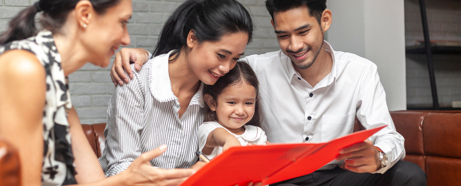 family reading together a book