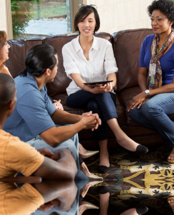 woman sharing something to group of people
